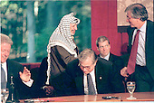 Wye Mills, MD - October 15, 1998 -- Palestinian Authority Chairman Yasser Arafat shakes hansd with members of the U.S. delegation to the talks with Israel on Thursday, October 15, 1998.  Pictured (L-R) U.S. President Bill Clinton; Chairman Arafat, National Security Advisor Sandy Berger; White House Press Secretary Joe Lockhart; and Special Envoy Dennis Ross..Credit: Robert Trippett - Pool / CNP