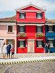 Tourists, The colorful village of Burano, Italy.