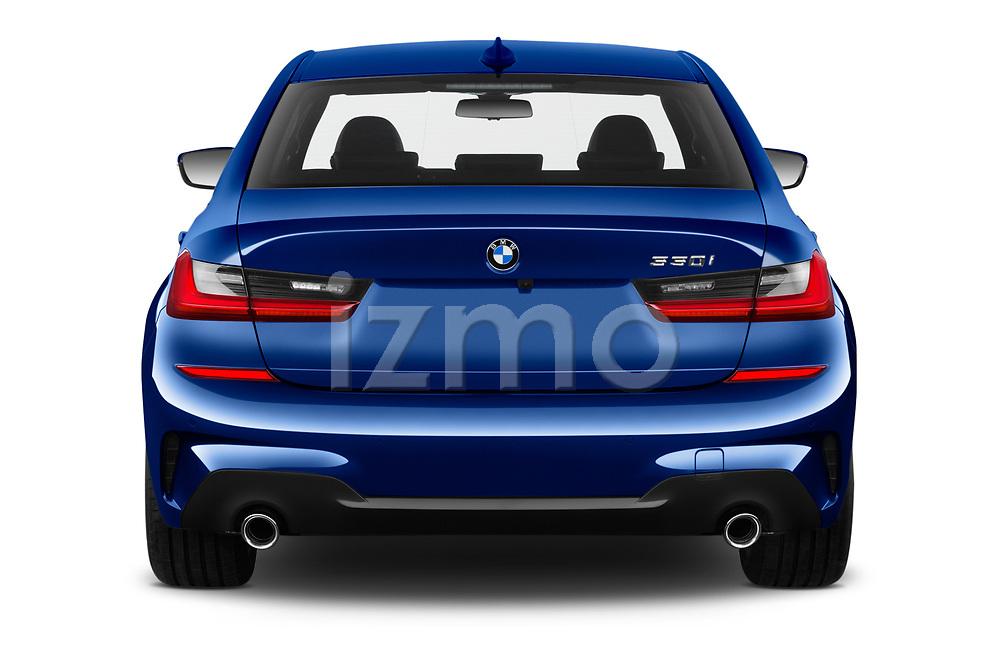 Straight rear view of 2019 BMW 3-Series M-Sport 4 Door Sedan Rear View  stock images