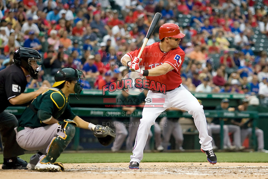 Texas Rangers designated hitter Michael Young (10) at bat against the Oakland Athetics in American League baseball on May 11, 2011 at the Rangers Ballpark in  Arlington, Texas. (Photo by Andrew Woolley / Four Seam Images)