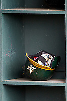 Josh Reddick's Oakland Athletics helmet in the Sacramento River Cats helmet rack during the Pacific Coast League baseball game against the Round Rock Express on June 19, 2014 at the Dell Diamond in Round Rock, Texas. The Express defeated the River Cats 7-1. (Andrew Woolley/Four Seam Images)