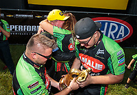Sep 3, 2018; Clermont, IN, USA; NHRA top fuel driver Terry McMillen celebrates with crew members after winning the US Nationals at Lucas Oil Raceway. Mandatory Credit: Mark J. Rebilas-USA TODAY Sports