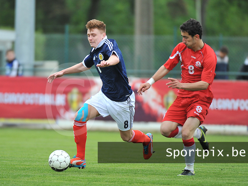 Scotland U19 - Georgia U19 : Lewis McLeod (8) and Avto Endeladze (right).foto DAVID CATRY / Nikonpro.be