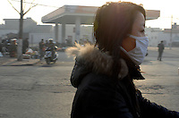A cyclist wears a protective masks as they make their way to work in Linfen, Shanxi Province, China. Linfen is reportedly the most polluted city in China and at the heart of the coal mining industry. China produces around 2.4 billion tones of coal annually that contributes to more than 400,000 premature deaths annually due to air pollution, acid rain and poisonous ground water. It also contributes to global warming...PHOTO BY SINOPIX