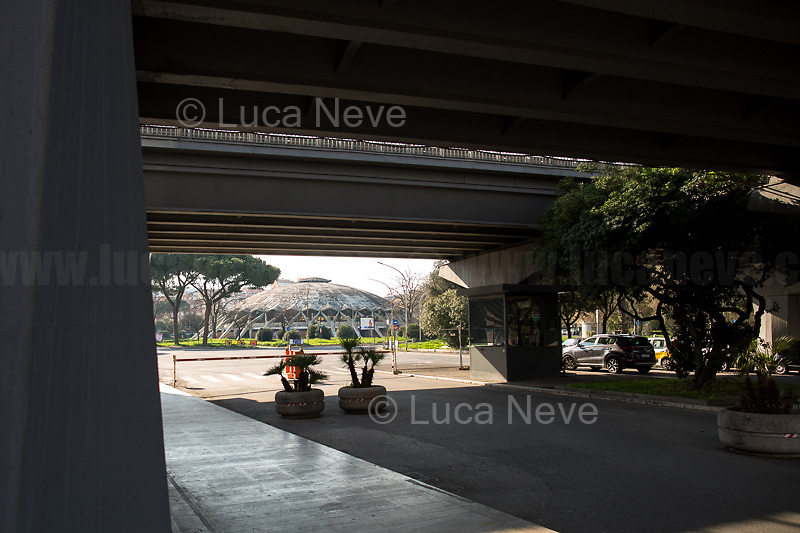 """Corso Francia viaduct (P.L. Nervi) Palazzetto dello Sport """"PalaTiziano"""" (A. Vitellozzi e P.L. Nervi).<br /> <br /> Rome, 18/03/2020. Rome's Olympic Village district under the Italian Government lockdown for the Outbreak of the Coronavirus SARS-CoV-2 - COVID-19. On 22 March, the Italian PM Giuseppe Conte signed a new Decree Law which suspends non-essential industry productions and contains the list of allowed working activities, which includes Pharmaceutical & food Industry, oil & gas extraction, clothes & fabric, tobacco, transports, postal & banking services (timetables & number of agencies reduced), delivery, security, hotels, communication & info services, architecture & engineer, IT manufacturers & shops, call centers, domestic personnel (1.).<br /> Updates: Italy: 22.03.20, 6:00PM: 46.638 positive cases; 7.024 recovered; 5.476 died.<br /> <br /> The Rome's Olympic Village (1957-1960) was designed by: V. Cafiero, A. Libera, A. Luccichenti, V. Monaco, L. Moretti. «Built to host the approximately 8,000 athletes involved in the 1960 Olympic Games, Rome's Olympic Village is a residential complex located between Via Flaminia, the slopes of Villa Glori and Monti Parioli. It was converted into public housing [6500 inhabitants, ndr] at the end of the sporting event. The intervention is an example of organic settlement, characterized by a strong formal homogeneity, consistent with the Modern Movement's principles of urbanism. The different architectural structures are made uniform by the use of some common elements: the pilotis, ribbon windows, concrete stringcourses, and yellow brick curtain covering. At the center of the neighborhood, the Corso Francia viaduct - a road bridge about one kilometer long - was built by P.L. Nervi[…]» (2.).<br /> <br /> Info COVID-19 in Italy: http://bit.do/fzRVu (ITA) - http://bit.do/fzRV5 (ENG)<br /> 1. March 22nd Decree Law http://bit.do/fFwJn (ITA)<br /> 2. (Atlantearchitetture.beniculturali.it MiBACT, ITA - ENG) http://bit.do/fFw3H<br """
