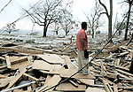 David Diaz looks over the area where he and his brother used to live in the Sadler Apartments on the waterfront in Biloxi, Mississippi August 29, 2005.  The pile of rubble and empty foundations are where once 30 or more apartments and over 100 of the St. Charles Condominiums.  Hurricane Katrina completely devistated Biloxi Mississippi and much of the gulf coast of Mississippi and Lousisana.