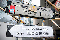 Hong Kong, Government Offices, 2 October 2014<br /> <br /> Students and other supporters of the Occupy Central movement congregating around the government offices area at Tamar. All the roads in the area are blocked from traffic and public transport.<br /> New True Democracy road sign.<br /> <br /> Photo Kees Metselaar