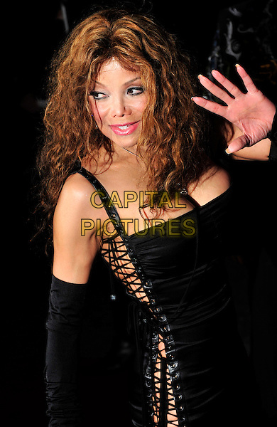 "LA TOYA JACKSON.The UK Premiere of ""The Imaginarium Of Doctor Parnassus"" at the Empire Leicester Square, London, England..October 6th 2009.Latoya half length black lace-up sides corset dress silver diamond bracelets sleeves arm warmers hand palm waving.CAP/CJ.©Chris Joseph/Capital Pictures."