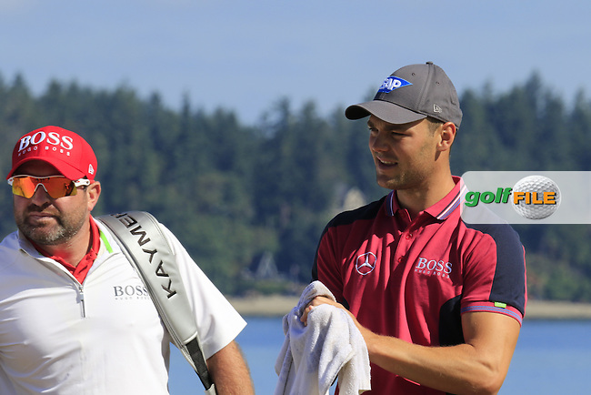 Martin Kaymer (GER) and caddy Craig Connolly on the 17th green during Wednesday's Practice Day of the 2015 U.S. Open 115th National Championship held at Chambers Bay, Seattle, Washington, USA. 6/17/2015.<br /> Picture &copy; Golffile/Eoin Clarke