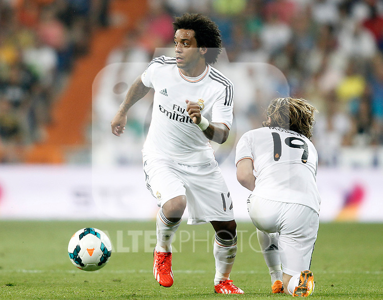 Real Madrid's Marcelo Vieira (l) and Luka Modric during La Liga match.August 18,2013. (ALTERPHOTOS/Acero)