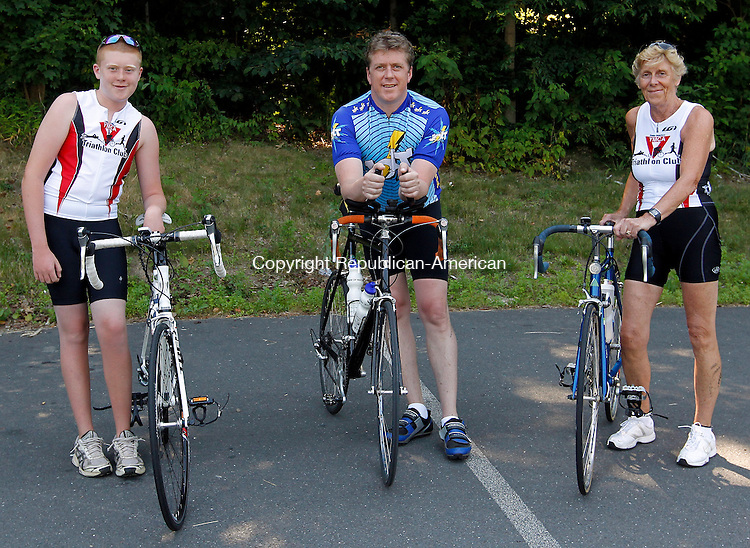 Watertown, CT-05, June 2010-070510CM04  (L-R) Jake Steel, 13, his father, Dave and grandmother, Joan pose on their bikes, which will be used when the compete in this years 24th annual BMW of Watertown Pat Griskus Sprint Triathlon.  This will be Jake's first Tri, as her father and grandmother are veterans and have competed in triathlons all over the state.  The 1/2mi open water swim, 10 mile bike and 3.1 mile run is scheduled to begin Wednesday evening at Lake Quassy in Middlebury. --Christopher Massa Republican-American