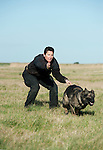 Schutzhund - Handler sending dog away, outside in field, UK
