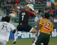 New England Revolution's Matt Reis against Los Angeles Galaxy's Pablo Chinchilla, July 4, 2005 at The Hime Depot Center.