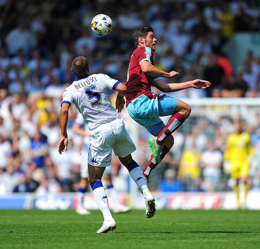 Burnley's Lukas Jutkiewicz vies for possession with Leeds United's Giuseppe Bellusci<br /> <br /> Photographer Chris Vaughan/CameraSport<br /> <br /> Football - The Football League Sky Bet Championship - Leeds United  v Burnley - Saturday 8th August 2015 - Elland Road - Beeston - Leeds<br /> <br /> &copy; CameraSport - 43 Linden Ave. Countesthorpe. Leicester. England. LE8 5PG - Tel: +44 (0) 116 277 4147 - admin@camerasport.com - www.camerasport.com