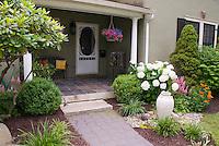 Hydrangea, ornamental urn, grasses, stones rocks, entry, front porch, house