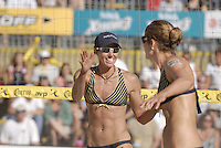 Huntington Beach, CA - 5/6/07:  Elaine Youngs, left, congratulates Nicole Branagh after scoring during Branagh / Youngs' 21-13, 21-13 loss to May-Treanor / Walsh in the championship match of the AVP Cuervo Gold Crown Huntington Beach Open of the 2007 AVP Crocs Tour..Photo by Carlos Delgado