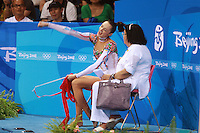 August 23, 2008; Beijing, China; Rhythmic gymnast Anna Bessonova of Ukraine celebrates score on ribbon with coach Albina Deriugina on way to winning bronze in the All-Around final at 2008 Beijing Olympics..(©) Copyright 2008 Tom Theobald