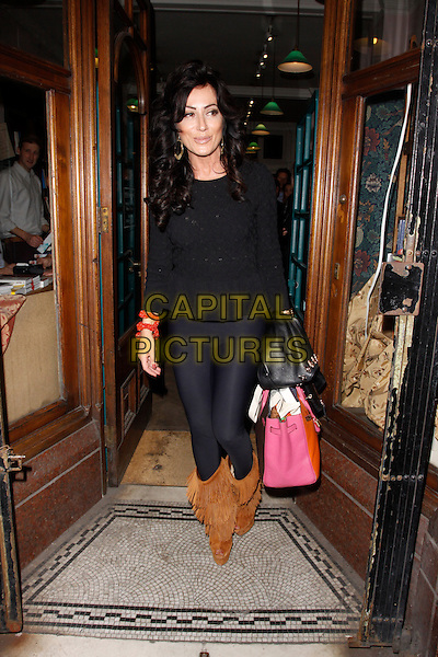 LONDON, ENGLAND - SEPTEMBER 23 :  Nancy Dell'Olio leaves the Stanley Johnson : Stanley I Resume - book launch party at Daunt Books on September 23, 2014 in London, England.<br /> CAP/AH<br /> &copy;Adam Houghton/Capital Pictures