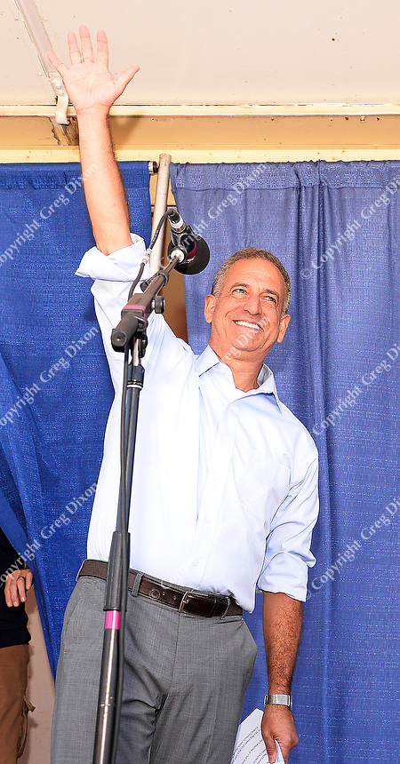 US Senate candidate, Russ Feingold, waves to the crowd at Fighting Bob Fest on Saturday, September 19, 2015 at Breese Stevens Field in Madison, Wisconsin
