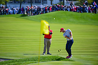 Kevin Chappell (USA) chips on to 3 during round 3 Four-Ball of the 2017 President's Cup, Liberty National Golf Club, Jersey City, New Jersey, USA. 9/30/2017.<br /> Picture: Golffile | Ken Murray<br /> <br /> All photo usage must carry mandatory copyright credit (&copy; Golffile | Ken Murray)