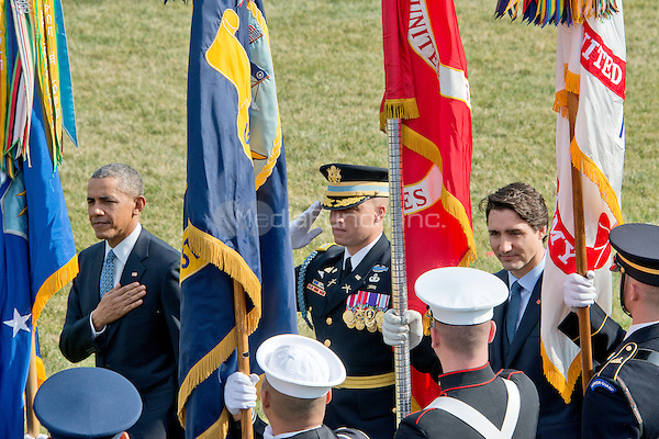 United States President Barack Obama, left, and Prime Minister Justin Trudeau of Canada, right, review the troops during an Arrival Ceremony on the South Lawn of the White House in Washington, DC on Thursday, March 10, 2016. <br /> Credit: Ron Sachs / CNP/MediaPunch