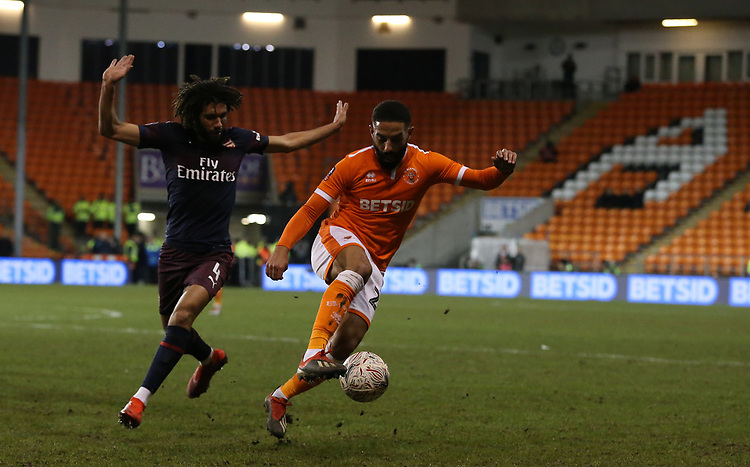 Blackpool's Liam Feeney shields the ball from Arsenal's Mohamed Elneny<br /> <br /> Photographer Stephen White/CameraSport<br /> <br /> Emirates FA Cup Third Round - Blackpool v Arsenal - Saturday 5th January 2019 - Bloomfield Road - Blackpool<br />  <br /> World Copyright &copy; 2019 CameraSport. All rights reserved. 43 Linden Ave. Countesthorpe. Leicester. England. LE8 5PG - Tel: +44 (0) 116 277 4147 - admin@camerasport.com - www.camerasport.com