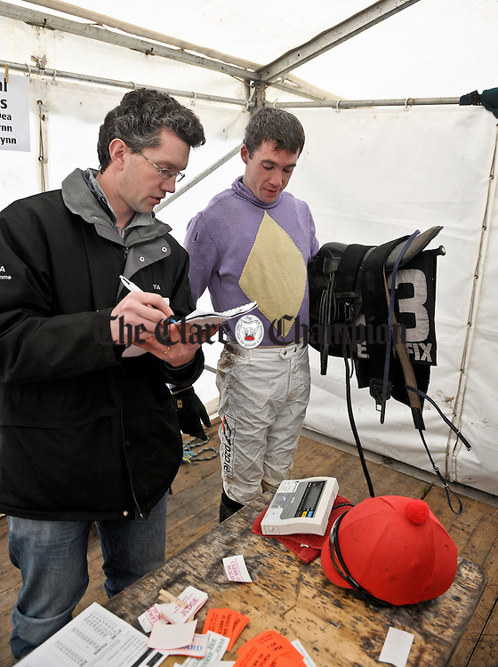 Jockey Derek O Connor is weighed in by assistant clerk of scales Jason Cummins at the Clare Hunt Point To Point in Bellharbour. Photograph by John Kelly.
