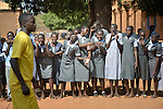 Students cheer for their team during a volleyball game at the John Paul II School in Wau, South Sudan.
