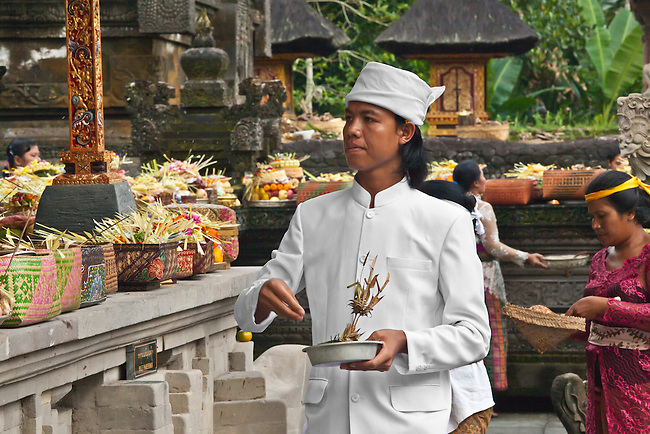 A Hindu priest makes offerings at the PURA TIRTA EMPUL TEMPLE COMPLEX during the GALUNGAN FESTIVAL -  TAMPAKSIRING, BALI, INDONESIA