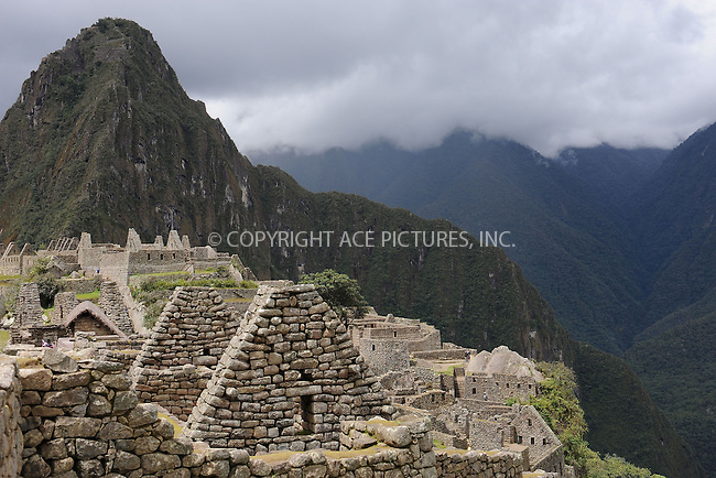 "WWW.ACEPIXS.COM . . . . . .January 8, 2013...Peru...Huayna Picchu also known as Wayna Picchu (Quechua: ""Young Peak"") is a mountain in Peru around which the Urubamba River bends. It rises over Machu Picchu, the so-called lost city of the Incas, and divides it into sections. The Incas built a trail up the side of the Huayna Picchu and built temples and terraces on its top. The peak of Huayna Picchu is about 2,720 metres (8,920 ft) above sea level, or about 360 metres (1,180 ft) higher than Machu Picchu... January 8, 2013 in Peru ....Please byline: KRISTIN CALLAHAN - ACEPIXS.COM.. . . . . . ..Ace Pictures, Inc: ..tel: (212) 243 8787 or 212 489 0521..e-mail: kristincallahan@aol.com...web: http://www.acepixs.com ."