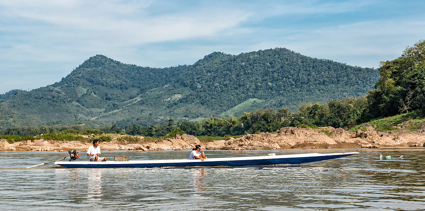 Two fishermen in a boat at work on the Mekong River near Luang Prabang, Laos
