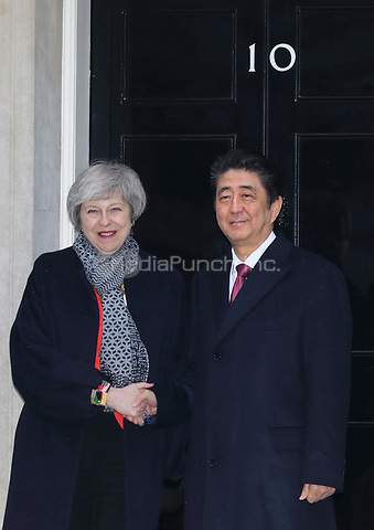 Prime Minister Theresa May and Prime Minister Shinzo Abe of Japan are seen on the steps of 10 Downing Street, London on January 10th 2019<br />
