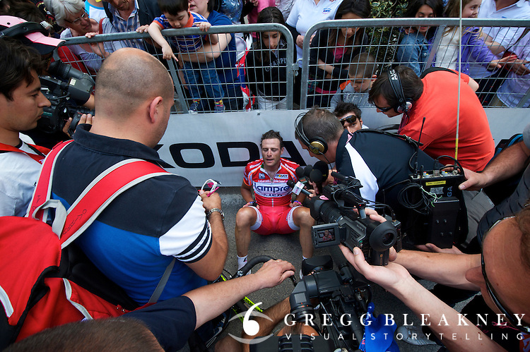 Alessandro Petacchi took a few minutes to catch his breath while sitting on the tarmac before taking journalist's questions about his near-stage victory. 2011 Giro d'Italia Stage 6