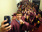 South Windsor senior Ben Kaczmarek, signals as he about to take a huge selfie of himself with most of his senior classmates,  prior to the South Windsor High School graduation ceremony, Monday, June 23, 2014, at Jorgersen Center for the Performing Arts at UConn. (Jim Michaud / Journal Inquirer)