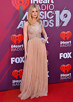 LOS ANGELES, CA. March 14, 2019: Elle Fanning at the 2019 iHeartRadio Music Awards at the Microsoft Theatre.<br /> Picture: Paul Smith/Featureflash