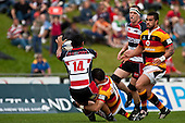 Lelia Masaga looks to get the pass away to Rees Logan as he is taken to ground by Stephen Donald. Air New Zealand Cup Rugby Game between Counties Manukau & Waikato, played at Bayer Growers Stadium Pukekohe on Saturday August 29th 2009. Waikato won 30 - 8.