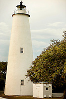 Ocracoke Light remains among the oldest lighthouses still active on the southern coast of North Carolina's Outer Banks, and it is the second oldest operating lighthouse in the United States (the first is Sandy Hook Light house in New Jersey). The first Ocracoke Lighthouse was built in 1803 on Shell Castle Island inside the Ocracoke Inlet not far from Blackbeard's hideout. Destroyed by lightning in 1818 it was replaced by the current light in 1823 on the banks of the inlet near Ocracoke Village. The white-brick conical lighthouse stands 75 feet tall and has 220 stairs to its top, though visitors are not allowed to climb. Ocracoke Island can only be reached by ferry. Charlotte NC photographer Patrick Schneider has extensive photo collections of the following lighthouses: Bodie Island Lighthouse, Bald Head Island Lighthouse, Cape Fear Lighthouse, Cape Hatteras Lighthouse, Cape Lookout Lighthouse, Currituck Beach Lighthouse, Diamond Shoal Lighthouse, Federal Point Lighthouse, Oak Island Lighthouse, and Ocracoke Lighthouse on Ocracoke Island.