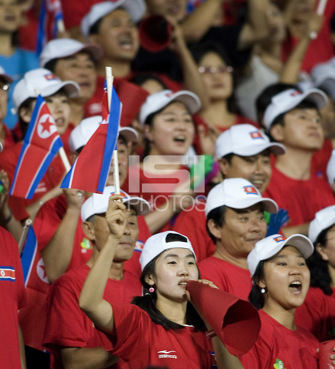 North Korean fans cheer on their team during their Group B first round game at the 2007 FIFA Women's World Cup at Chengdu Sports Center Stadium in Chengdu, China on September 14, 2007. North Korea (PRK) defeated Nigeria (NGA), 2-0.
