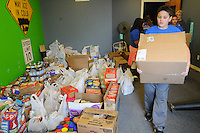NWA Democrat-Gazette/FLIP PUTTHOFF <br /> Michael Townzen, fifth-grader at Elza Tucker Elementary, delivers food items Tuesday Nov. 24, 2015 to First Baptist Church in Lowell. Students in Candace Pierce's fifth-grade class organized a food driver that netted more than 3,800 food items.