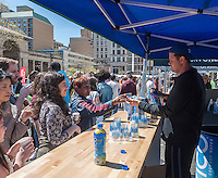 Workers give away samples of Zico Coconut Water at an Earth Day fair in Union Square in New York on Sunday, April 17, 2016. Zico is a brand of the Coca-Cola Company. (© Richard B. Levine)