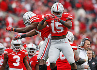 Ohio State Buckeyes running back Ezekiel Elliott (15) celebrates a 44-yard touchdown run with teammate running back Warren Ball (28) during the 4th quarter of the NCAA football game against the Michigan Wolverines at Ohio Stadium on Nov. 29, 2014. (Adam Cairns / The Columbus Dispatch)