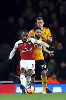 Alexandre Lacazette of Arsenal and Joao Moutinho of Wolves during Arsenal vs Wolverhampton Wanderers, Premier League Football at the Emirates Stadium on 11th November 2018