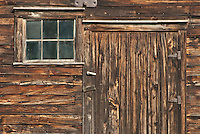 An old barn door and window show their age, Door County, Wisconsin