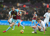 Burnley's Ashley Barnes battles with Swansea City's Sam Clucas<br /> <br /> Photographer Ashley Crowden/CameraSport<br /> <br /> The Premier League - Swansea City v Burnley - Saturday 10th February 2018 - Liberty Stadium - Swansea<br /> <br /> World Copyright &copy; 2018 CameraSport. All rights reserved. 43 Linden Ave. Countesthorpe. Leicester. England. LE8 5PG - Tel: +44 (0) 116 277 4147 - admin@camerasport.com - www.camerasport.com