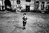 Wroclaw 13.05.2006 Poland<br /> The worst and the most dangerous district in Wroclaw ( Poland ) , called by people &quot;The Bermuda Triangle&quot;. There are walls bearing an inscription &quot;Who will enter here, will not exit alive&quot; Many families there are pathological and live in extreme poverty. Children have no place for any games so they loaf around on this wasted district and disseminate a juvenile delinquency. Many of them become sexually active though they are only 10-12 years old<br /> (Photo by Adam Lach / Napo Images)<br /> <br /> Najbardziej nabezpieczna dzielnica we Wroclawiu zwana przez ludzi Trojkatem Bermudzkim. Sa tam sciany opatrzone napisem &quot; Kto tu wejdzie, nigdy nie wyjdzie stad zywy&quot; Mieszka tam wiele rodzin patologicznych i zyja w wielkiej nedzy. Dzieci wlocza sie po ulicach nie majac miejsc na zabawe i szerza przestepczosc wsrod nieletnich. Wiele z dzieci uprawia seks choc maja zaledwie 10-12 lat<br /> (Fot Adam Lach / Napo Images)