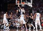GLENDALE, AZ - APRIL 03: Zach Collins #32 of the Gonzaga Bulldogs shoots the ball over Justin Jackson #44 of the North Carolina Tar Heels during the 2017 NCAA Men's Final Four National Championship game at University of Phoenix Stadium on April 3, 2017 in Glendale, Arizona.  (Photo by Jamie Schwaberow/NCAA Photos via Getty Images)