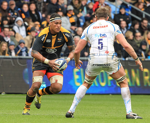 09.04.2016. Ricoh Arena, Coventry, England. European Champions Cup. Wasps versus Exeter Chiefs.  Wasps No8 Nathan Hughes on the charge covered by Chiefs James Hanks