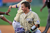 J.D. Long (3) of the Western Carolina Catamounts walks to drive in the winning run in the bottom of the ninth inning of a SoCon Tournament game against Wofford College on Wednesday, May 25, 2016, at Fluor Field at the West End in Greenville, South Carolina. Western won, 10-9. (Tom Priddy/Four Seam Images)