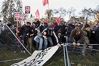 Protestors break down barriers constructed to prevent them reaching the Houses of Parliament on Parliament Square during a student demonstration in Westminster, central London on the day the government passed a bill to increase university tuition fees.