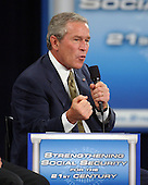 """United States President George W. Bush participates in a """"Conversation on Strengthening Social Security"""" at Montgomery Blair High School in Silver Spring, Maryland on June 23, 2005.  The President used the forum sponsored by the National Retirement Planning Coalition (NPRC) to reinforce his call for personal retirement accounts as part of Social Security reform. <br /> Credit: Ron Sachs / Pool via CNP"""